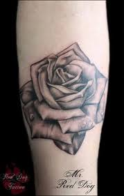 traditional rose tattoo on right forearm