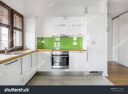 high gloss white kitchen big window stock photo 651758968
