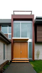 modern entry doors for home with glass inserts under white carved