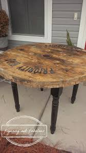 outdoor tables made out of wooden wire spools this is so cool cable spool table made with four turned legs diy