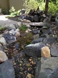 backyard stream install u2013 calgary contractors water landscape