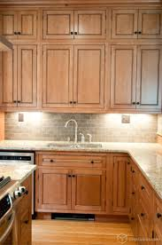 kitchen cabinet backsplash unbelievable with light wood cabinets and black countertops of