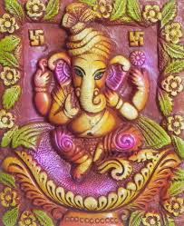 sitting ganesha on a plaque wall hanging terracotta