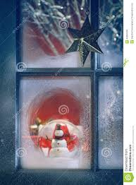 frosted window with christmas decorations inside stock photo
