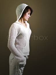 young beautiful in white dress with a hood stock photo