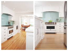 white kitchen cabinets with aqua backsplash white kitchen with aqua backsplash tiles and upgraded stove