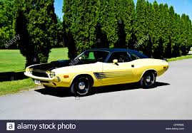 Dodge Challenger 1974 - 1974 yellow and black dodge challenger on pavement stock photo