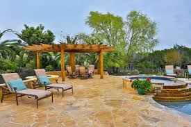 Flagstone Patio With Pergola Tropical Patio With Exterior Stone Floors U0026 Raised Beds In Boerne