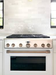 what color appliances with white cabinets the white and brush bronze cafe appliances that my
