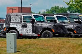 jeep truck 2 door spied 2018 jeep wrangler two door caught in the open motor trend
