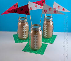 football party favors 20 diy football decorations for a tailgate tablescape thegoodstuff