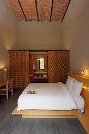 bedroom grey floor wooden bed frame hidden lamps classic look