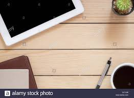 office desk table with tablet coffee cup pen and notebook top