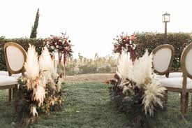 wine country wedding inspiration with a pampas grass arch ruffled