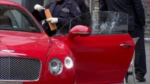 red bentley man wounded in suspected drive by shooting while sitting in red