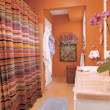 large bathroom design with orange wall paint with vanity and large bathroom design with orange wall paint with vanity and bathtub and orange floor image