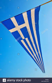 Greece Flag Colors Waving Greece Flag In The Blue Sky And Flagpole Stock Photo