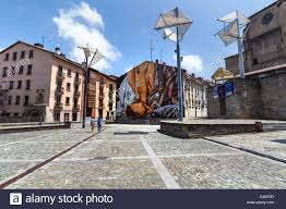 large wall mural in the plaza de las brullerias showing the large wall mural in the plaza de las brullerias showing the various traditional trades in vitoria gasteiz basque country spain