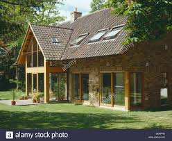 velux windows and sliding glass doors on modern country house with