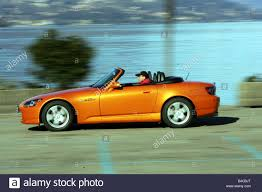 honda convertible car honda s 2000 model year 2005 orange convertible driving