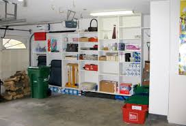 small spaces garage organization after remodel with wooden cabinet