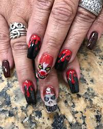 this woman doesn u0027t mess around with her halloween nail art abc news
