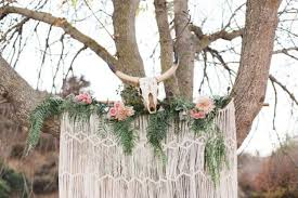 wedding backdrop tree picture of a macrame wedding backdrop with ferns pink roses and