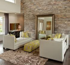 please view the following spectacular living rooms with stone wall