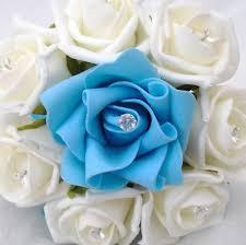 turquoise flowers flowers flowergirls posy bouquet ivory roses turquoise ribbon