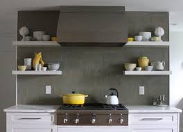 white kitchen cabinets with gray tile backsplash contemporary