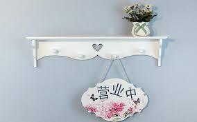 White Bathroom Shelf With Hooks by White Shelf With Hooks Kiera Grace Riley Wall Shelf And Picture