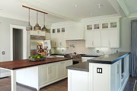 lights island in kitchen soapstone countertops kitchen transitional with industrial pendant