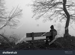 grieving man sitting alone on bench stock photo 267923864