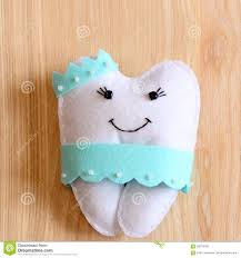 felt tooth fairy doll on wooden background cute felt tooth fairy