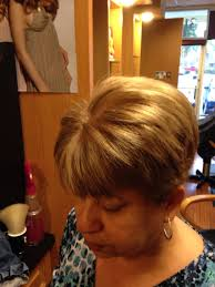blonde color with fun lowlights on short hair hair design by