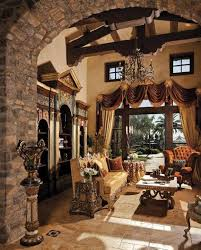 inside a tuscan home living room with exposed beams inside a