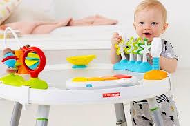 table d eveil avec siege table d activité bébé évolutive avec siège et 25 jeux d éveil
