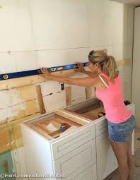 How To Mount Kitchen Wall Cabinets How To Install Interest Install Kitchen Cabinets Home Interior