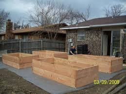 recently built 4 new raised beds for vegetable garden in our