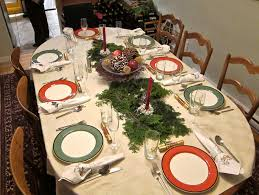 christmas banquet table decorations with red candle on pottery