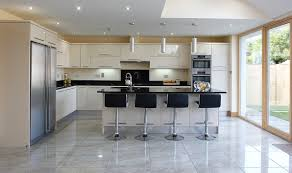 stunning u shape fitted kitchen featuring black kitchen cabinets