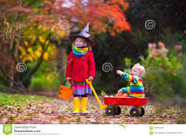kids trick or treat at halloween stock photo image 59462524