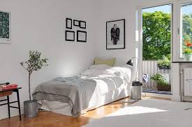 nice bedroom with white walls and single bed buying tips for