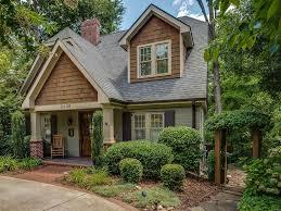 craftsman exterior of home with exterior brick floors u0026 pathway in