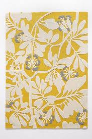 tufted yellow white rug
