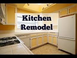 how to fit a kitchen cheaply how to remodel your kitchen on a budget two tone cabinets kitchen remodel