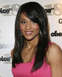 a side part with long hair and a swoop and a cross 22 ciara hairstyles ciara hair pictures pretty designs