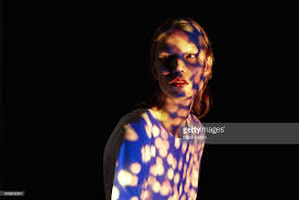 interesting lighting young woman with interesting lighting stock photo getty images