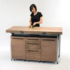 kitchen island storage table phil crook s workstation nests above your stovetop and sink before
