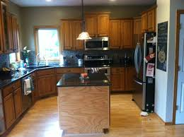 should i paint or stain my oak kitchen cabinets much oak in my kitchen should i stain and or paint